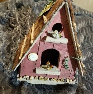 Birdhouse with cute little bird inhabitants
